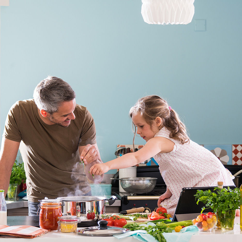 Dad and daughter cooking dinner together